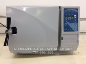 This is one of our beautifully re-manufactured Tuttnauer EZ9 Automatic Autoclaves showing the trays in the chamber.