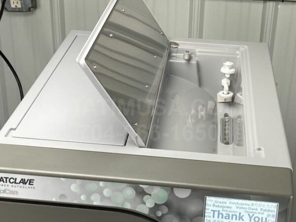 This is a Scican Statclave G4 autoclave with the clean water reservoir access door open.