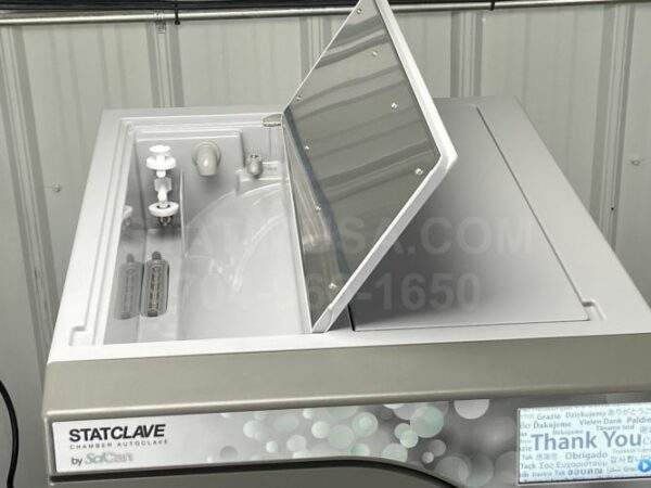 This is a Scican Statclave G4 autoclave with the venturi reservoir access door open.