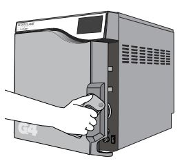 Opening the door on a Scican Statclave G4 chamber autoclave