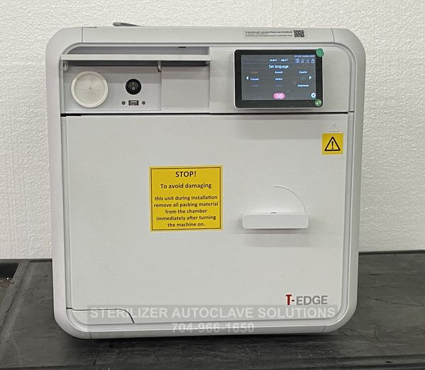 This is the front view of a Tuttnauer T-Edge 10S 220v 10″X18″ Chamber Autoclave with the access door open