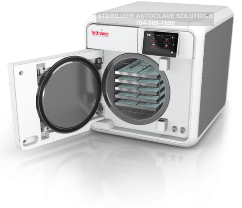 This is a Tuttnauer T-Edge 11 autoclave with the door open.